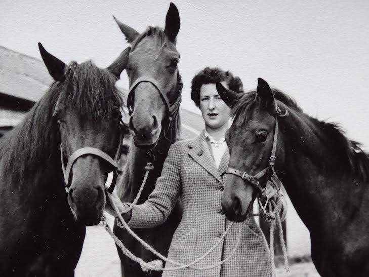 Rita in her 20s with horses